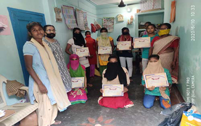 Distribution of sewing certificates  at Digha center